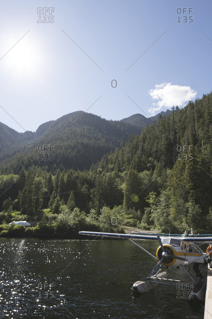 Floatplane on a lake surrounded by forest