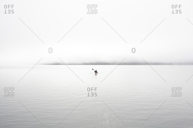 Woman kayaking on the calm water