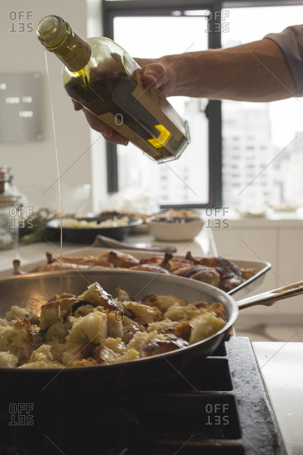 Pouring olive oil on stuffing