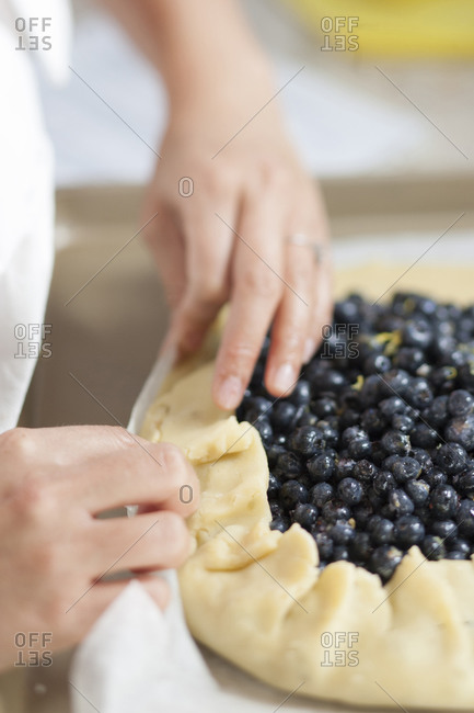 Preparing the crust of a blueberry pie