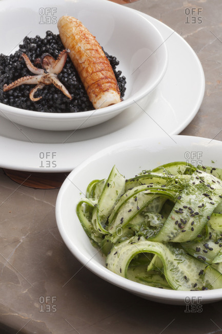 Cucumber salad and seafood with black couscous