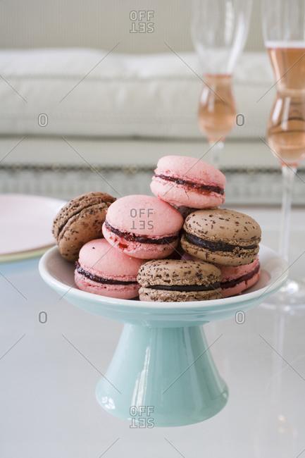 Pink and brown macarons on a glass table