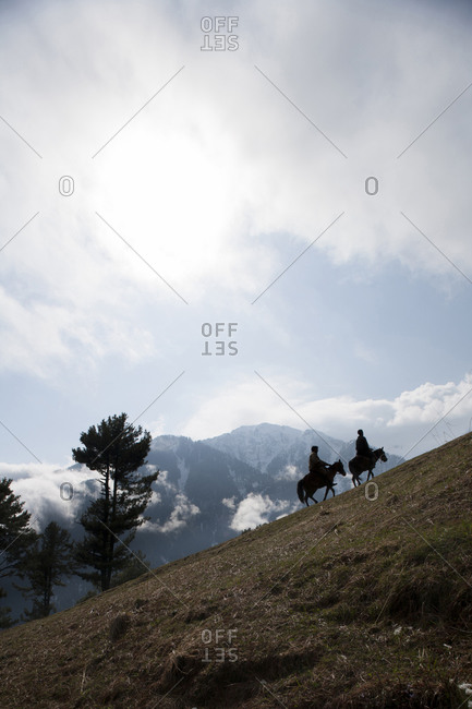 Two mule riders in the mountains