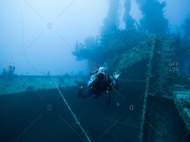 Grenada, Caribbean Sea, Scuba diver next to shipwreck