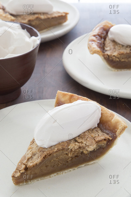 Shoofly pie slices on plates with creme