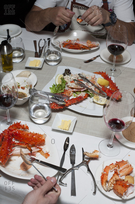Dinner table with people eating spiny crab