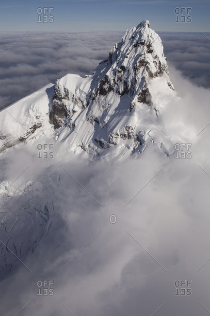 Aerial view of Corcovado volcano surrounded by clouds