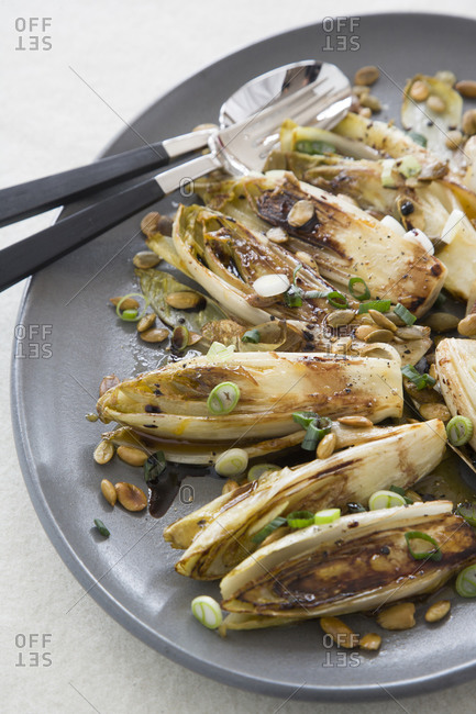 Braised endives dish with chopped scallions