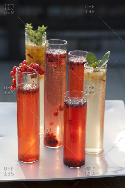 Fruit Bellini cocktails on tabletop with garnish