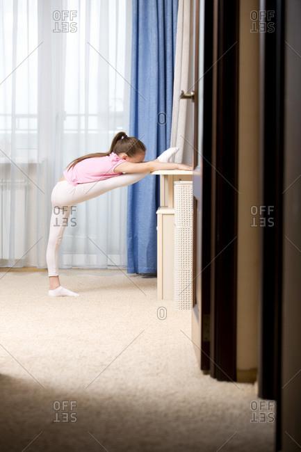 Girl practicing ballet in her room