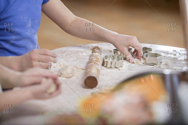 Two girls preparing dough for baking