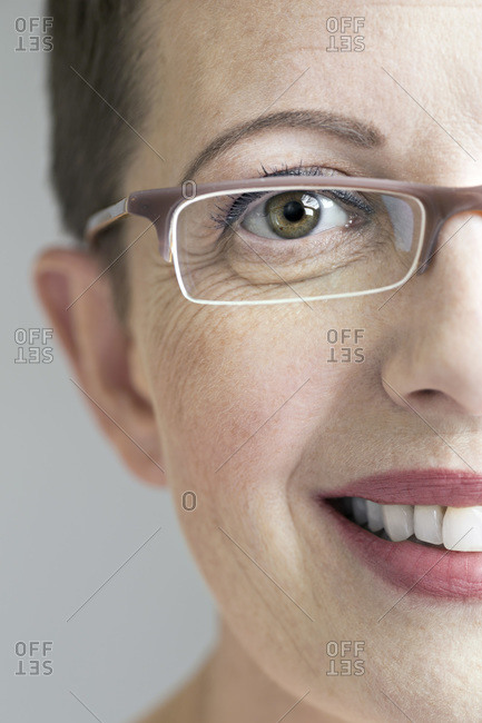 Close up of smiling woman with glasses