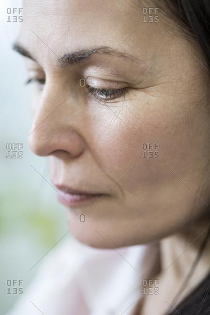 Pensive woman looking down