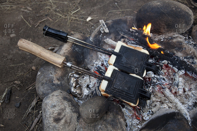 Two toasted sandwich makers on the campfire in Jindabyne, New South Wales, Australia