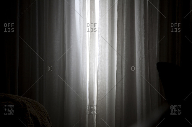 Sunlight coming in through slightly parted curtains in a bedroom