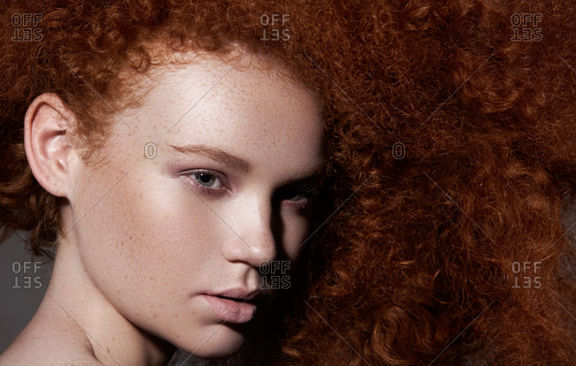 Head shot of red headed model