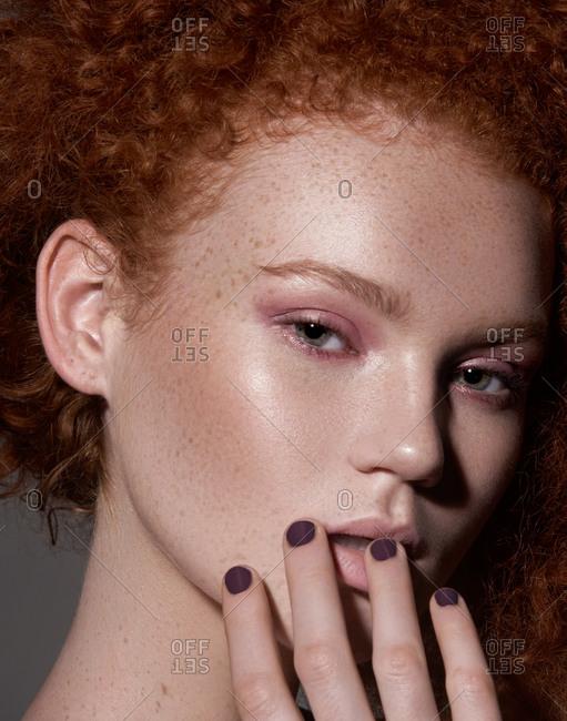 Head shot of red headed model