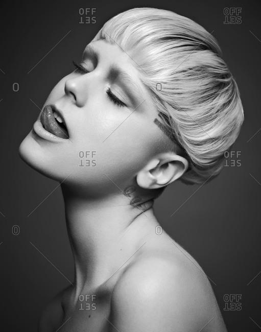 Blonde model licking lips