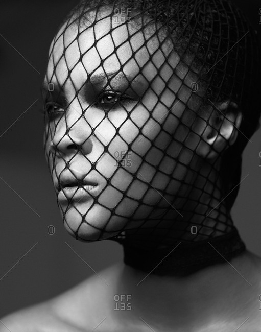 Head shot of dark-haired model with face net
