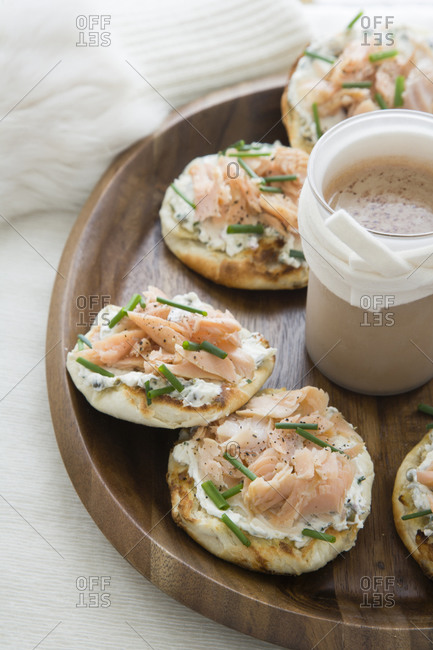 English muffins on tray with smoked salmon and chives