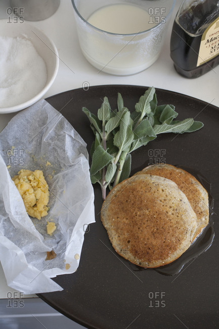 Kitchen countertop with butter, sage and cornmeal pancake
