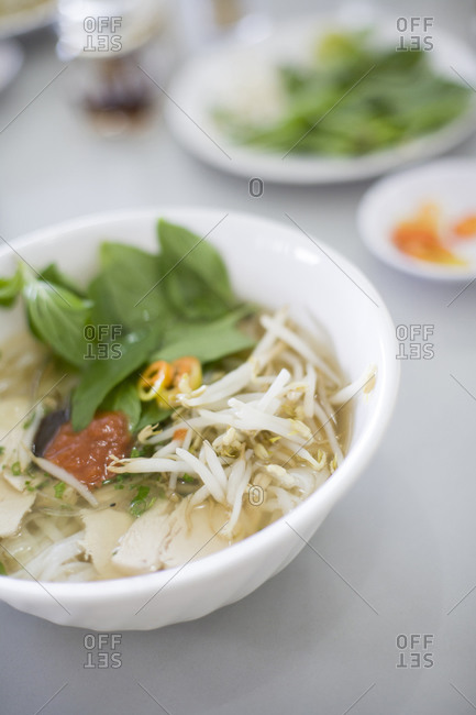 Bowl of pho soup with vegetables