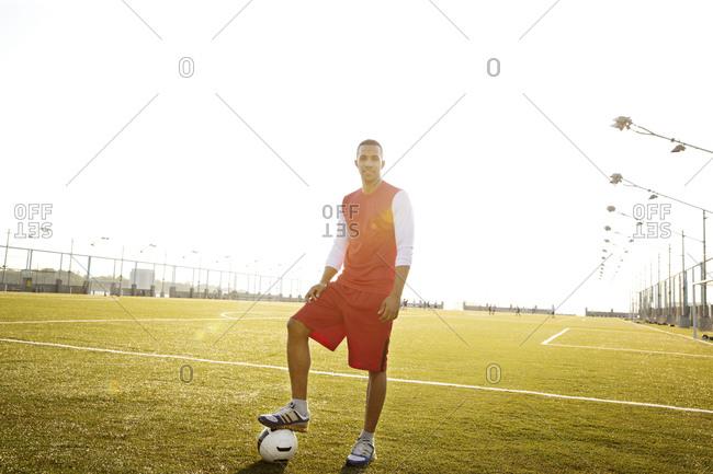 Man in uniform standing on soccer field