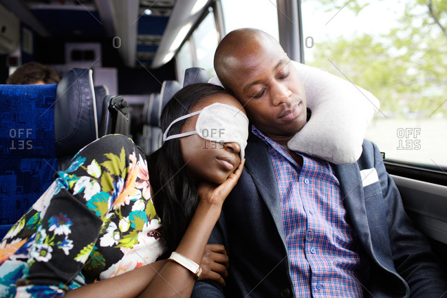 Couple sleeping together on a bus