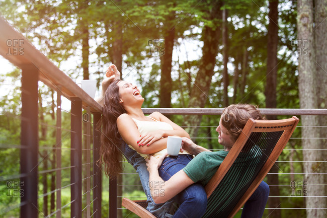 Young couple having fun on porch