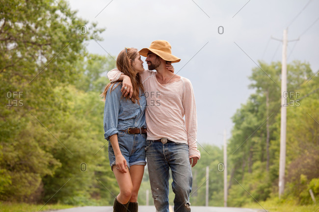 Young couple embracing each on the road