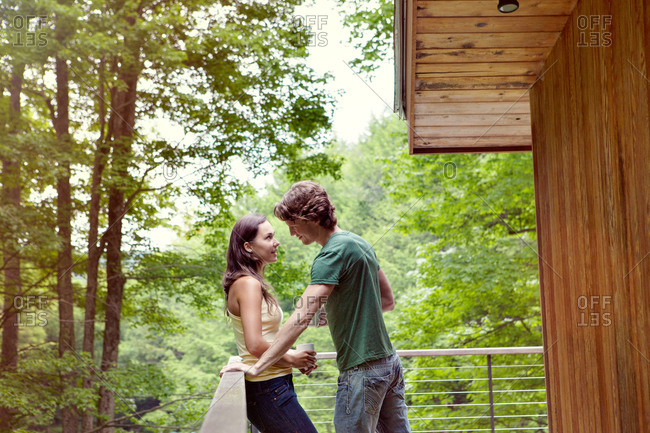 Young couple having conversation on porch