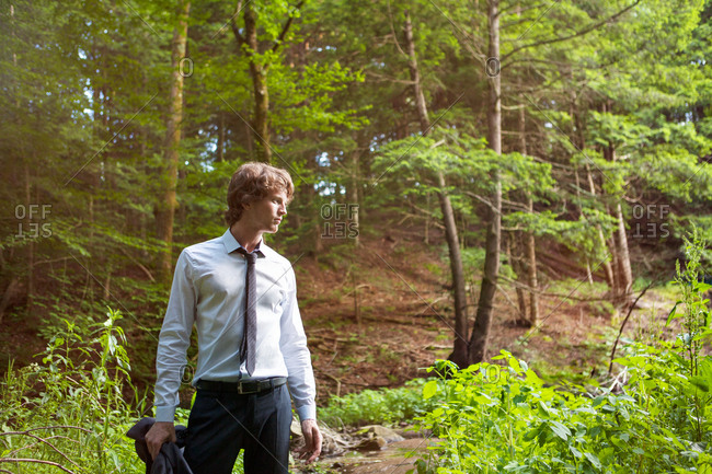 Young man standing in the forest