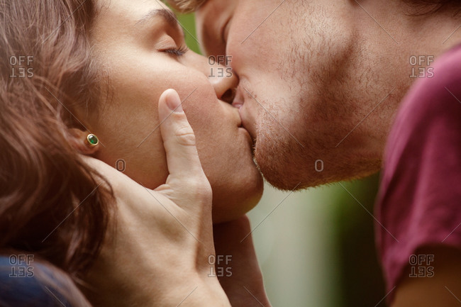 Close-up of young couple kissing