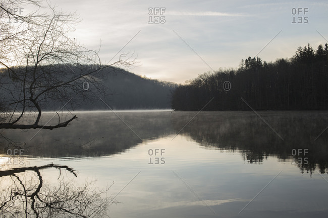 Still morning waters on lake in Dutchess County in winter