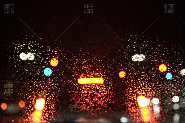 Car and streetlights through a wet windscreen