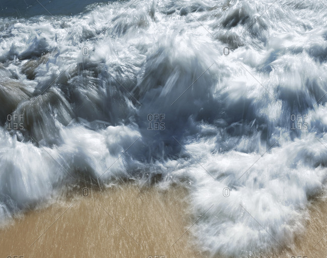 Waves crashing the sandy beach