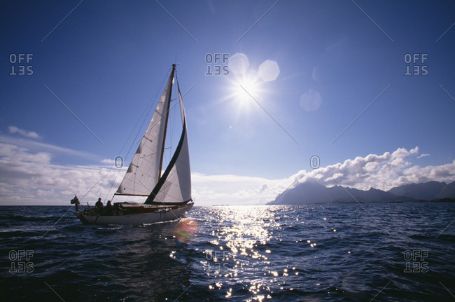 Sailing boat under the sun
