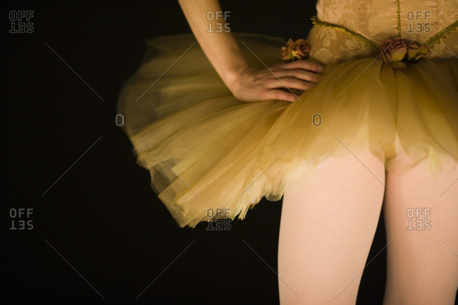 Mid section view of a ballerina in tutu dancing