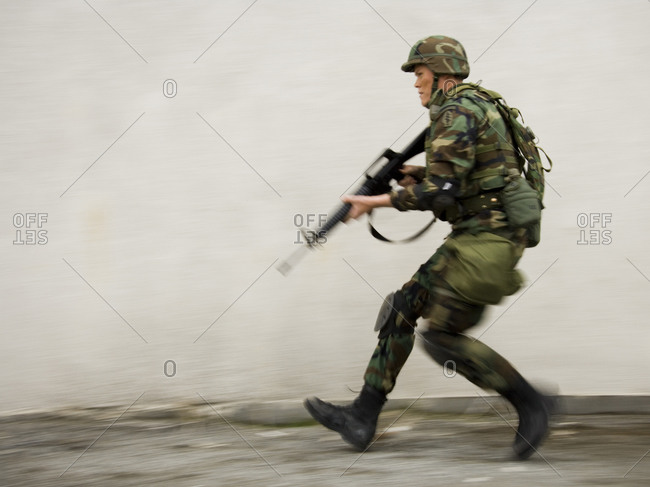 Soldier aiming weapon