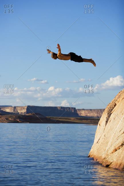 Man high in the air diving into water