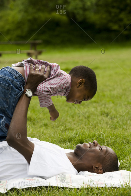 Father and son outside playing