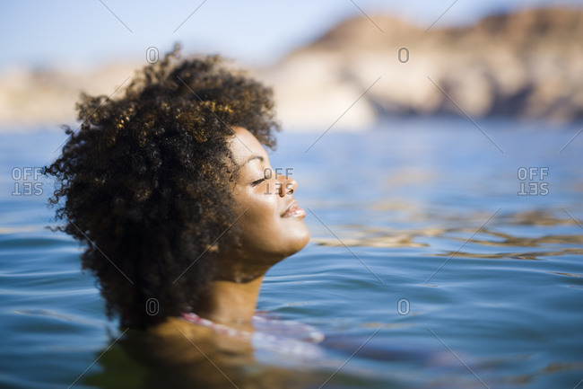 Woman in water with only her head above