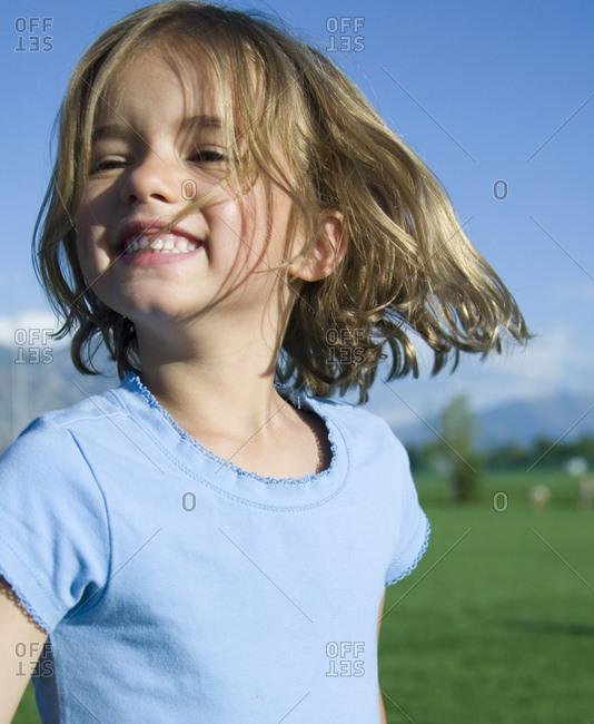 Girl smiling outside