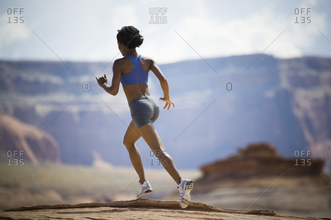 Woman jogging from the Offset Collection