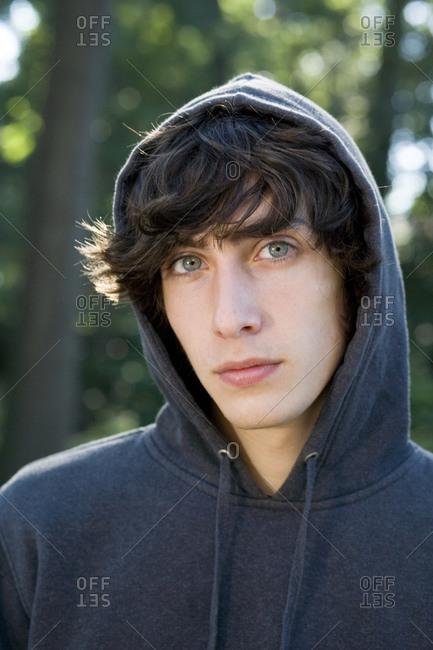 Teenage boy wearing hoodie