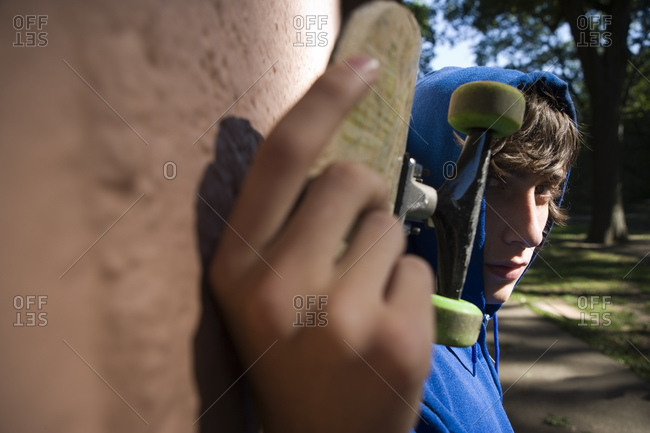 Close up of teenager with skateboard
