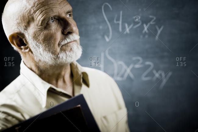 Male school teacher with books