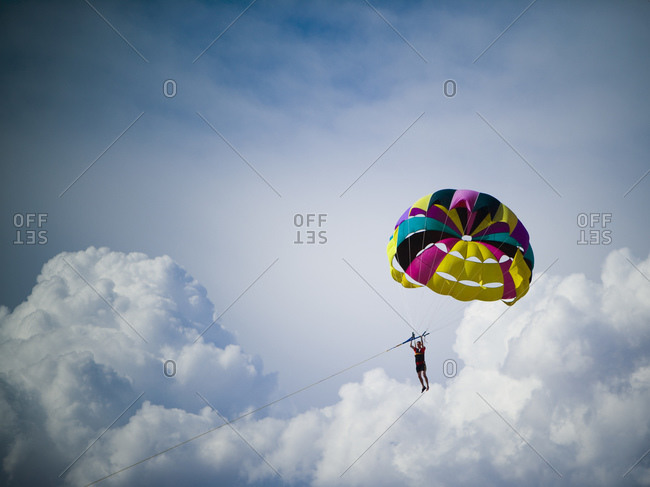 Man with parachute floating