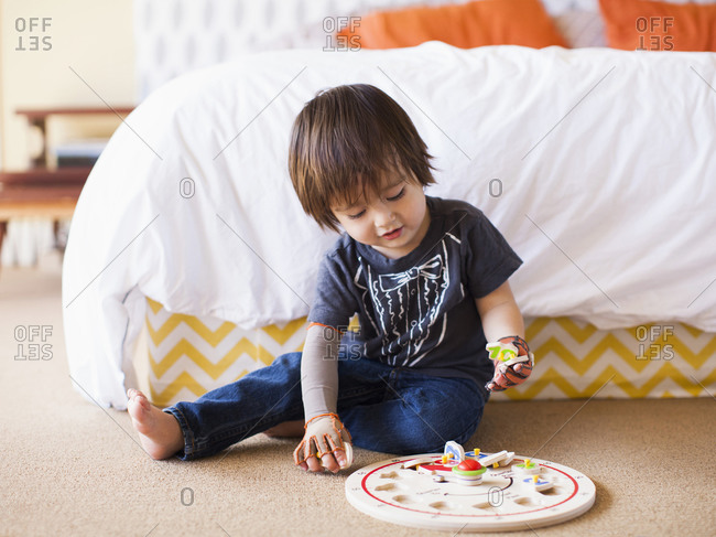 Baby boy (2-3) playing in bedroom