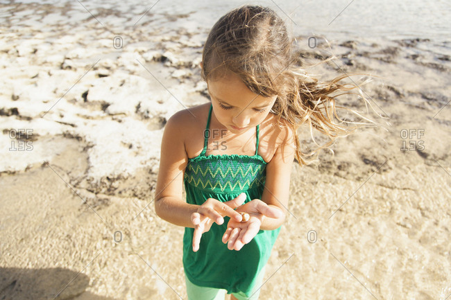 Girl (6-7) playing on beach